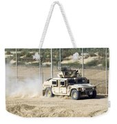 A M1114 Humvee Patrols The Perimeter Weekender Tote Bag