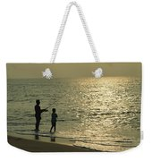 A Man And A Young Boy Fish In The Surf Weekender Tote Bag