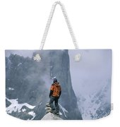 A Man Stands On A Cliff Watching Weekender Tote Bag