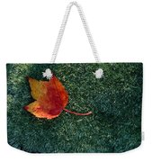 A Maple Leaf Lies On Emerald Moss Weekender Tote Bag