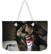 A Military Policeman Collects Materials Weekender Tote Bag