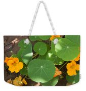 A Mix Of Orange Flowers And Round Green Leaves With Sun And Shadow Weekender Tote Bag