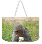 A Monkey Enjoying An Ice Cream Cone Inside Delhi Zoo Weekender Tote Bag