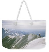 A Mountain Climber Hikes Weekender Tote Bag