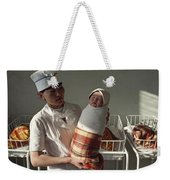A Nurse Holds A Tightly Wrapped Newborn Weekender Tote Bag