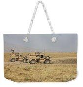 A Pair Of U.s. Army Cougar Mrap Weekender Tote Bag