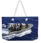 A Rigid-hull Inflatable Boat Carrying Weekender Tote Bag