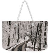 A Road Running Through Snow-covered Weekender Tote Bag