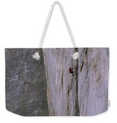 A Rock Climber Clings To An Overhang Weekender Tote Bag