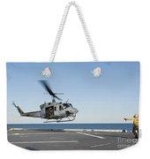 A Sailor Directs A Uh-1n Huey Weekender Tote Bag