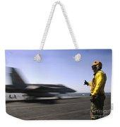 A Sailor Ensures An Fa-18c Hornet Weekender Tote Bag by Stocktrek Images