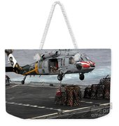 A Sailor Hooks Cargo To An Mh-60s Sea Weekender Tote Bag