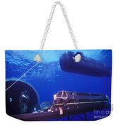A Seal Delivery Vehicle Hovers Weekender Tote Bag