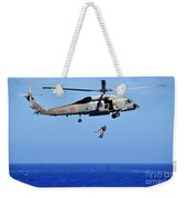 A Search And Rescue Swimmer Is Lowered Weekender Tote Bag