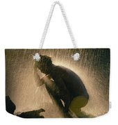 A Silhouetted Man Cooling Off In Water Weekender Tote Bag