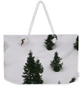 A Skier Makes His Way Down A Hill Weekender Tote Bag