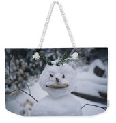 A Smiling Snowman With Twig Arms Weekender Tote Bag
