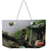A Soccer Ball Flies Over The Head Weekender Tote Bag