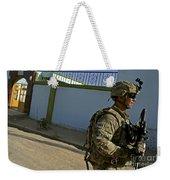A Soldier Patrols The Streets Of Qalat Weekender Tote Bag