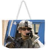A Soldier Talking Via Radio Weekender Tote Bag by Stocktrek Images