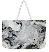A Strong Storm Lingering In The Center Weekender Tote Bag