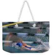 A Swimmer Races Through The Water Weekender Tote Bag