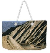 A Truck Is Dwarfed By Eroded Desert Weekender Tote Bag