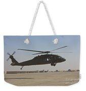 A Uh-60 Black Hawk Landing Weekender Tote Bag