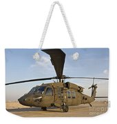 A Uh-60 Black Hawk Parked At A Military Weekender Tote Bag