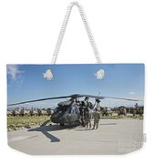 A Uh-60l Blackhawk Parked On Its Pad Weekender Tote Bag