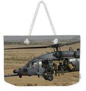 A U.s. Air Force Hh-60 Pavehawk Flies Weekender Tote Bag