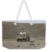 A U.s. Army Cougar Patrols A Wadi Weekender Tote Bag