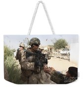 A U.s. Marine Gives A Piece Of Candy Weekender Tote Bag