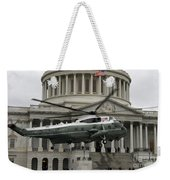 A Vh-60 Helicopter Lands In Front Weekender Tote Bag