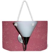 A Wall Mounted Lamp Set Against A Pink Printed Wall Color Weekender Tote Bag