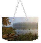 A Weathered Rowboat On The Shore Weekender Tote Bag