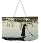 A Woman Stands At The End Of A Rowboat Weekender Tote Bag