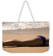 A Woman Sunbathes On The Beach Weekender Tote Bag