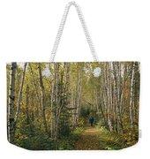 A Woman Walks Down A Birch Tree-lined Weekender Tote Bag