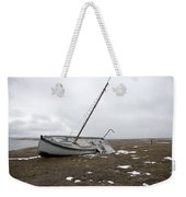 A Wooden Sailboat Is Beached Weekender Tote Bag