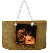 A Young Chimpanzee Held Captive Weekender Tote Bag