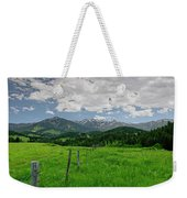 Afternoon Clouds Over The Crazy's Weekender Tote Bag