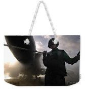 Airman Holds Up The Safety Shot Line Weekender Tote Bag by Stocktrek Images