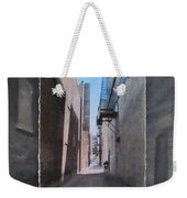 Alley With Guy Reading Layered Weekender Tote Bag by Anita Burgermeister