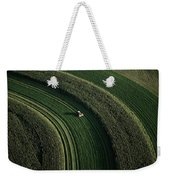 An Aerial View Of A Tractor On Curved Weekender Tote Bag