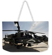 An Ah-64d Apache Helicopter Parked Weekender Tote Bag