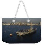An Aircraft Carrier With The Skyline Weekender Tote Bag
