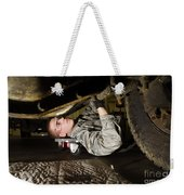 An Airman Inspects The Undercarriage Weekender Tote Bag by Stocktrek Images