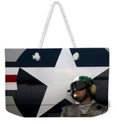 An Airman Stands In Front Of A C-2a Weekender Tote Bag