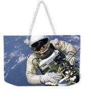An Astronaut Floats And Maneuvers Weekender Tote Bag